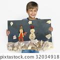 Children having fun with snowman artwork 32034918