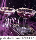 Two alcohol cocktails with berries on purple 32044373