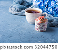 Cup of tea on blue background with flowers 32044750