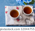 Cup of tea on blue background with flowers 32044755