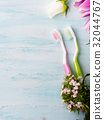 Two pastel toothbrushes with flowers herbs 32044767