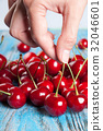 Red cherry in hand 32046601
