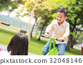Mother with son playing seesaw in the park. 32048146