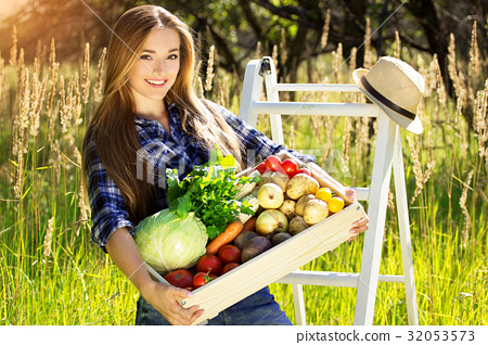 Summer harvest in the countryside village. 32053573