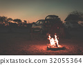Burning camp fire at dusk 32055364