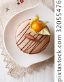 French macaroon decorated with chocolate 32055476