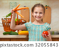 child girl with vegetables in kitchen interior 32055843