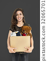 Woman Studio Portriat Casual Carrying a Box Isolated 32065701