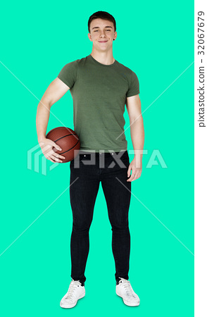 Young adult muscular man holding basketball 32067679