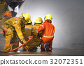 Fireman.Firefighters fighting fire during training 32072351