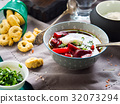 Beetroot soup served in bowls on napkin 32073294