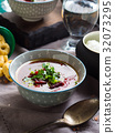 Beetroot soup served in bowls on napkin 32073295