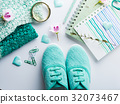 Green pastel lifestyle woman clothes flat lay 32073467