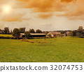 Cows graze on a meadow at sunset France. Landscap 32074753