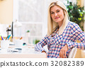 Young woman sitting at her desk 32082389