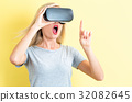 Young woman using a virtual reality headset 32082645