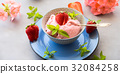Home made strawberry ice cream in bowl 32084258