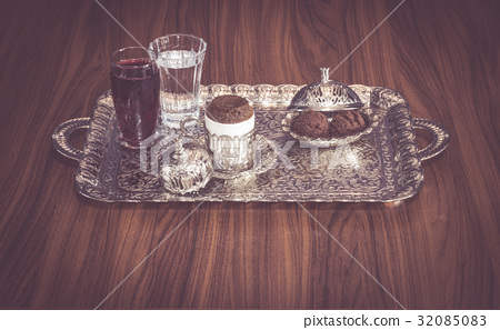 Turkish coffee served with water, sherbet, cookie  32085083