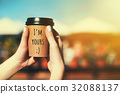 Paper coffee cup in woman's hand 32088137
