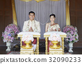 A couple with the string headpiece and and garland are smiling in the wedding ceremony. 32090233