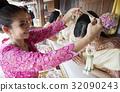 A woman is garlanding a bride 32090243