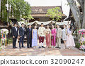 A picture of a group at the wedding ceremony. 32090247