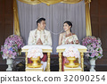 Groom and bride are looking and smiling each other. 32090254