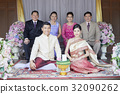 A photo of a happy family at the wedding ceremony 32090262