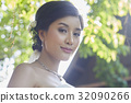 A photo of a beautiful bride smiling. 32090266