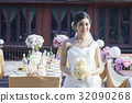 A picture of a beautiful bride standing alone. 32090268