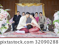 bride and groom are sitting and holding hand each other 32090288