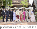 people are standing for taking photo with bride and groom  32090311