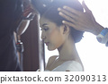 The hair of bride is being prepaired for her wedding 32090313