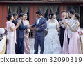 Bride and groom is blessed by their guests in wedding reception 32090319
