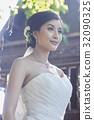a photo of young bride smiling and looking away 32090325
