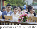 The married couple are smiling happily while the others are chatting together 32090365