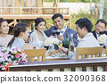 the couple are clinking happily and the others are toasting for their congratulations 32090368