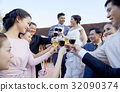 Everyone is standing and toasting while the couple are looking lovely each other 32090374