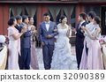 guests are clapping for the happy bride and groom outdoors 32090389