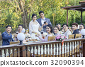 groom, bride and guests are toasting champagne at garden wedding 32090394