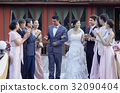 guests are congratulating the bride and groom at wedding reception 32090404