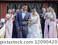 guests are clapping and looking at happy newlywed couple 32090420