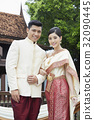 A portrait of a Thai couple taking a photo in the wedding. 32090445