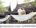 A couple is holding hand and standing in a balcony of the house 32090486