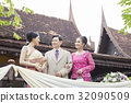 The elder couple is looking and smile with the bride 32090509