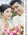 The portrait of bride and groom smiling happily 32090514