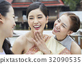 Three girls are laughing together 32090535