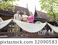 a photo of a bride and her parents side by side and being  happy in her wedding. 32090583