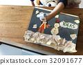 Children having fun with snowman artwork 32091677