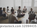 Group of people training in yoga class for body soul and mind relief 32094435